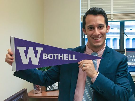 Jared Mead holding UW Bothell pennant
