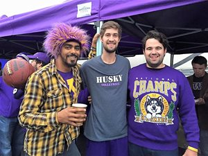 Three Husky fans on game day.