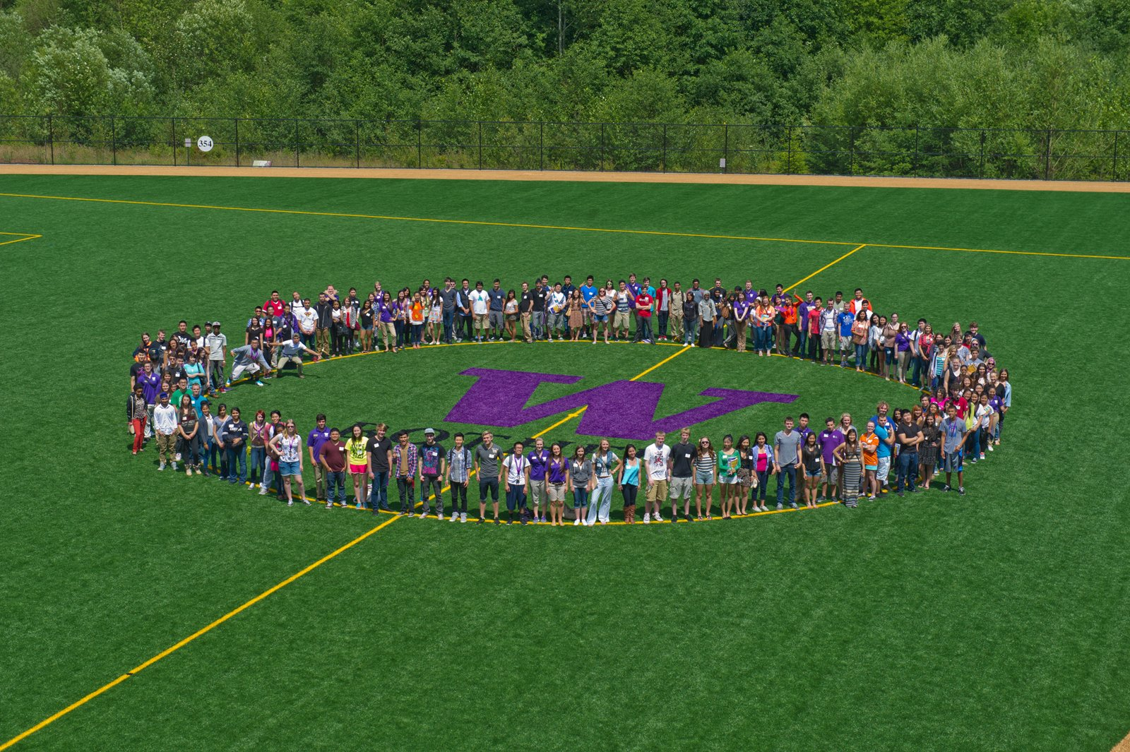 Group picture of students standing in a circle